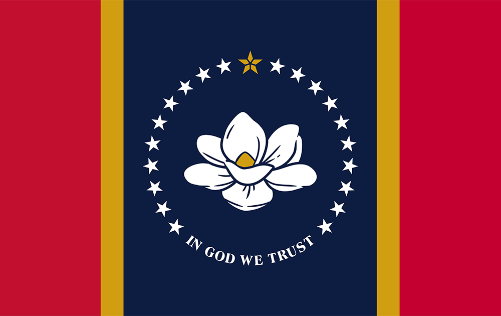 """Two vertical thick red stripes and thin gold stripes flank either side of a navy blue stripe in the center, which boasts a large blooming white magnolia flower, its petals unfurling. Circled by 20 stars and white text below: """"IN GOD WE TRUST"""""""
