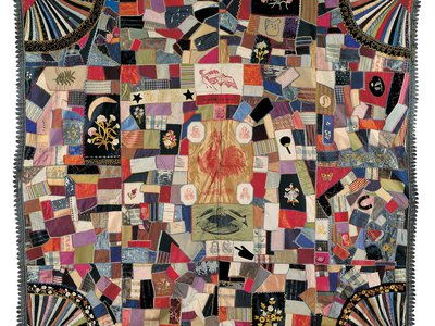 """A """"crazy quilt""""—a chaotic style without repeating features—by an unidentified 19th-century artist incorporates politicians' campaign banner portraits."""