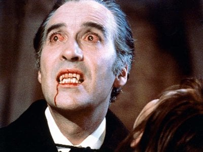 Christopher Lee as the titular vampire in Terence Fisher's 1958 Dracula, showing off bloody canines that would prove weirdly influential.