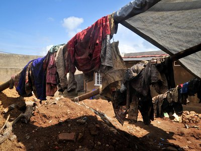 Clothes of genocide victims whose bodies were recently exhumed hang outside at the site of the mass grave in Gasabo district, near the capital Kigali, in Rwanda