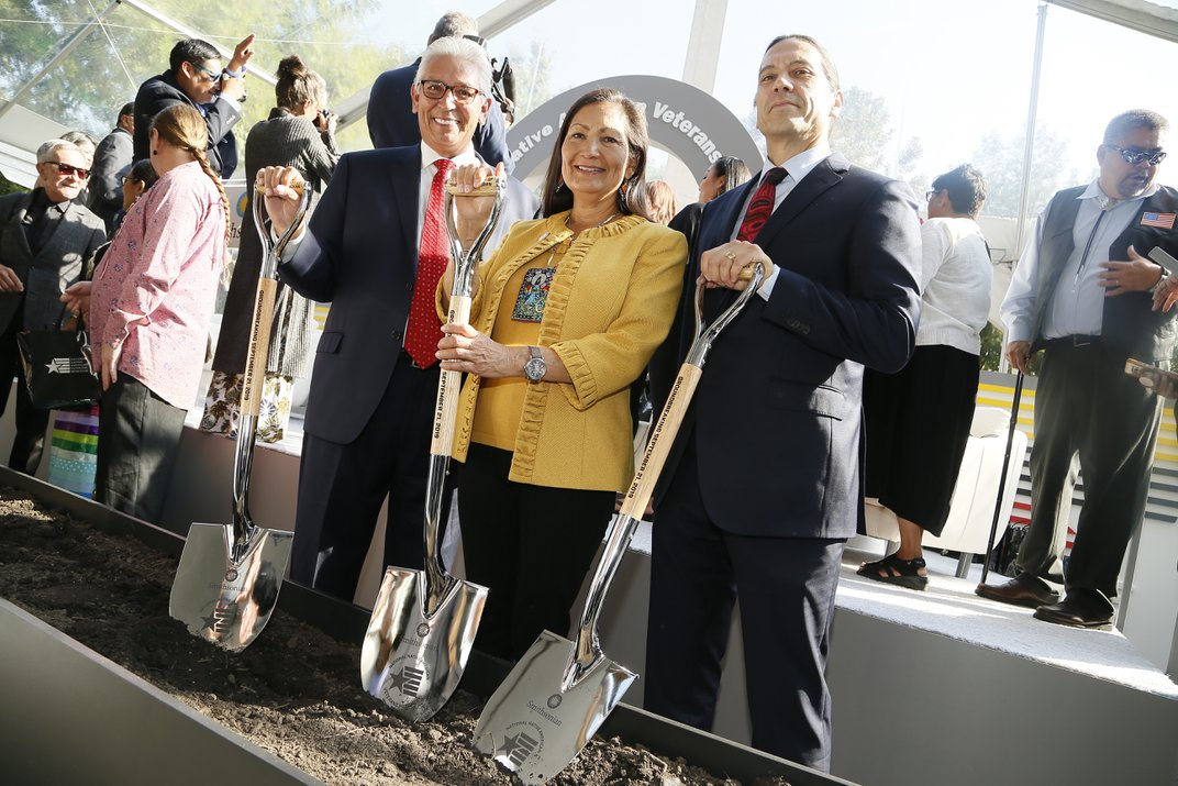 Deb Haaland with Kevin Gover and Bill Lomax at the groundbreaking ceremony for the National Native American Veterans Memorial in Washington, DC.