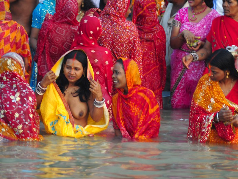 """HOLY BATH IN GANGES - LADIES ENJOYING BATH IN THE HOLY RIVER """"GANGES"""".PHOTOGRAPHED IN KOLKATA - INDIA."""