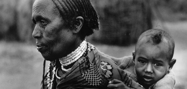 A grandmother in Ethiopia carries her grandchild.