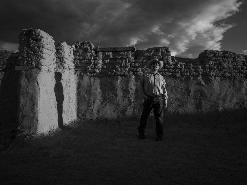 Genízaro Delvin Garcia standing in remains of the 18th-century Santa Rosa de Lima Church. Abiquiú, New Mexico, 2019. (© 2020 Russel Albert Daniels)