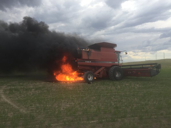 Combine on fire in wheat field. thumbnail