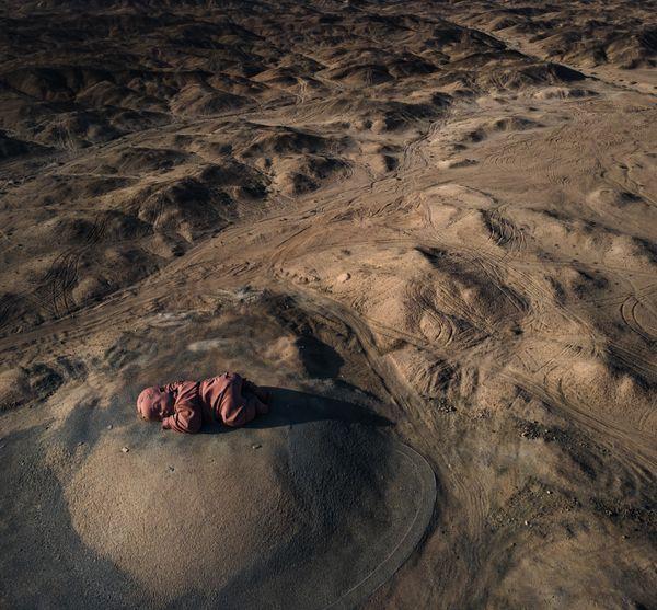 A Child Sleeps In The Desert thumbnail