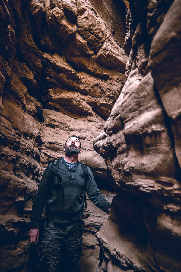 Which way out? A tourist navigates through the Slot canyon in Anza-Borrego State Park. thumbnail