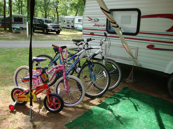 Four bicycles next to a camper thumbnail