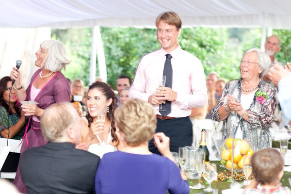 People celebrate and enjoy themselves at a wedding reception thumbnail