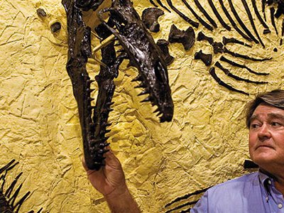 """Fossil prospector Ron Frithiof (with a mosasaur from his collections) was sued over a T. rex that he uncovered.  """"This whole experience,"""" he says, """"has been a disaster."""""""