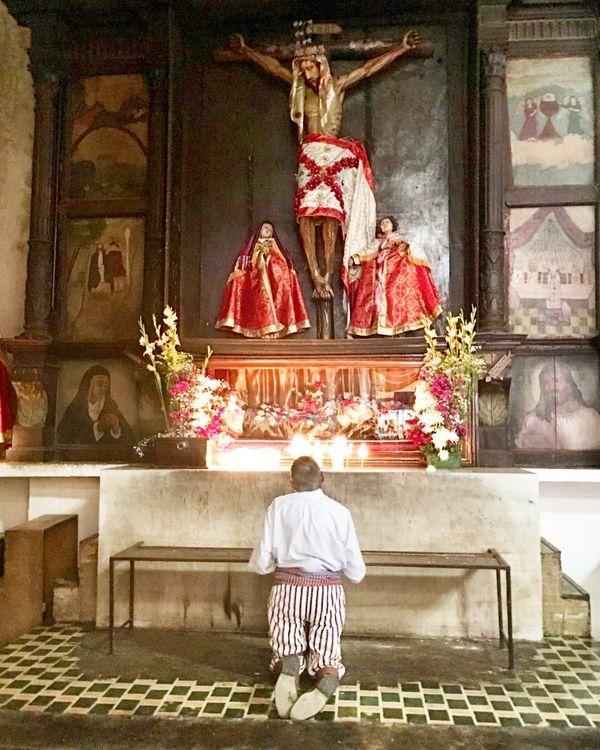 A Mayan Catholic man praying on Lake Atitlan thumbnail
