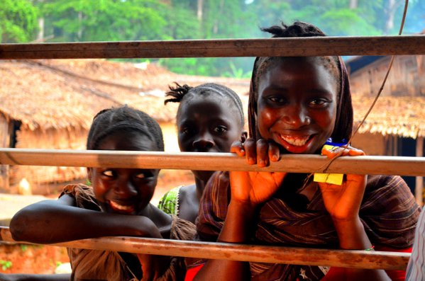 Village children check out the reading competition in Voinjama, Lofa County, Liberia. thumbnail