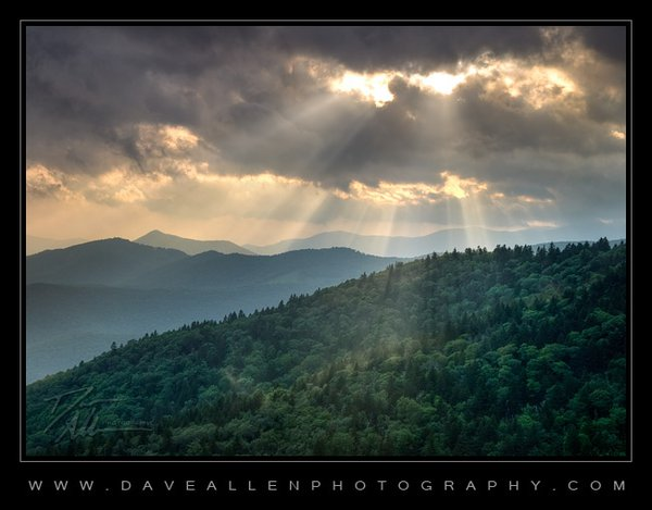 Sun beams punch though the summer clouds along the Blue Ridge Parkway thumbnail