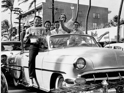 In this March 13, 1959 file photo, A group of supporters of statehood drive through the street in Waikiki, Honolulu, Hawaii.