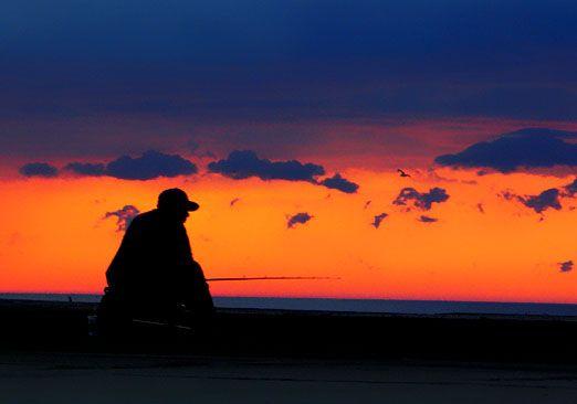 Fishing on breakwater, South Haven, Michigan thumbnail