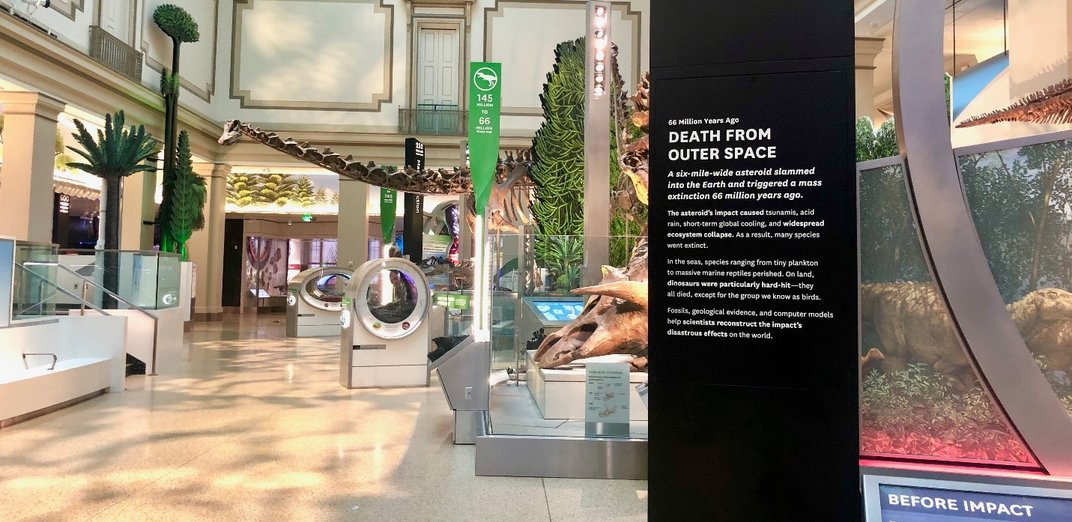 """""""Death From Outer Space"""" in white on a black sign in the Smithsonian's new fossil hall."""
