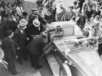 President Franklin D. Roosevelt exits a car during a campaign stop in California. Roosevelt was the first U.S. president with a visible disability, caused by polio.