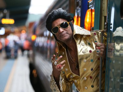 Elvis tribute artist Alfred Kaz, also known as 'Bollywood Elvis' poses at Central Station ahead of boarding the 'Elvis Express' on January 10, 2019 in Sydney, Australia.