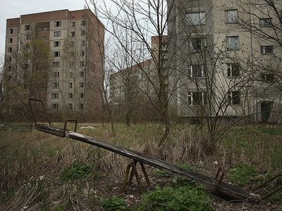 A children's seesaw stands among former apartment buildings in Pripyat, Ukraine. Pripyat, built in the 1970s to house the workers and families of the Chernobyl Nuclear Power Plant, now stands abandoned inside the Chernobyl Exclusion Zone.