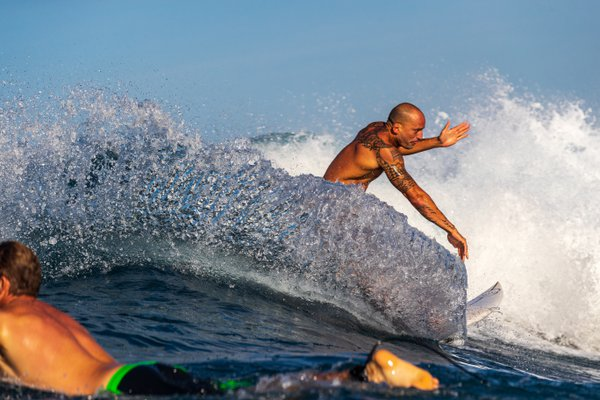 A Surfer Makes a Turn on a Wave in Hawaii-- Carving Glass thumbnail