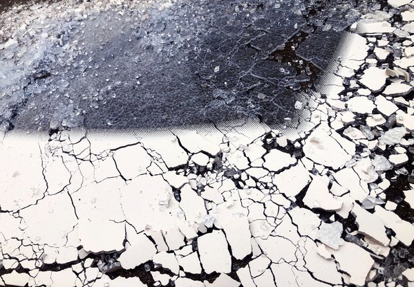 Shattered glass covering the road. thumbnail