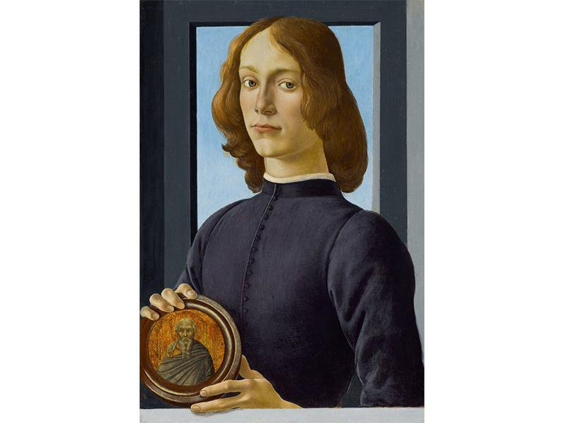 A young man faces the viewer, with gray-green eyes, pale skin and gold-brown hair, wearing a dark purple tunic, in front of a simple gray window with a plain blue sky; holds a circular medallion with his two hands depicting an elderly saint
