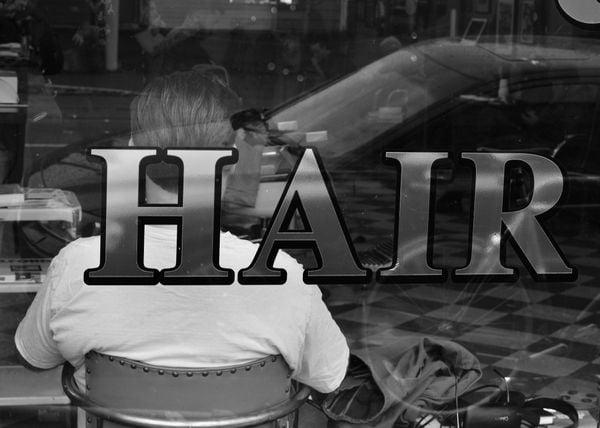A dude waiting for a hair cut. thumbnail
