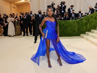 """Poet and Met Gala co-chair Amanda Gorman channeled the Statue of Liberty in this sheer blue Vera Wang dress. Her clutch, emblazoned with the phrase """"Give Us Your Tired,"""" references Emma Lazarus' """"The New Colossus,"""" which is inscribed on a plaque at the American landmark."""