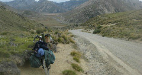 """The author's bicycle patiently poses in a land of """"beauty, heartbreak and challenge"""" in the Molesworth wilderness."""