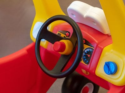 The little red car with the yellow roof that is propelled by foot power has been a hit with young children since its creation in 1979.