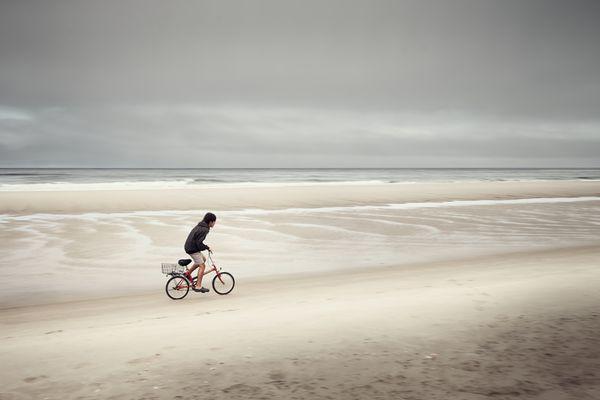Boy On Bike On Beach thumbnail