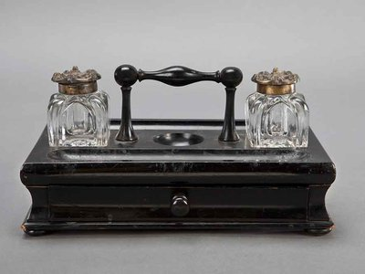 From the desk of Susan B. Anthony, this inkstand was used  by the women's rights advocate to produce the articles she wrote for her newspaper The Revolution.