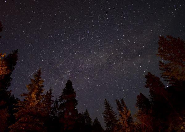 Satellites skating across the Milky Way thumbnail