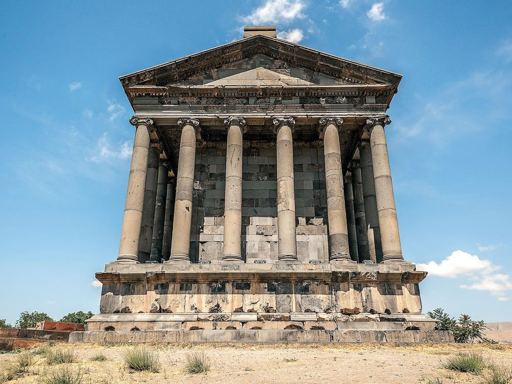 The pagan temple and the ruins of the fortress in the village of Garni