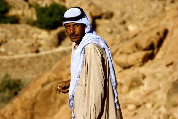 27 year old Sherpa in Sinai Egypt smoking a cigarette. thumbnail