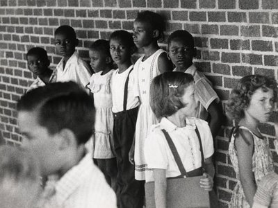 In July 1955, black children wait to register for school in Lawrence County, Arkansas, as schools desegregate in the wake of Brown v. Board of Education.