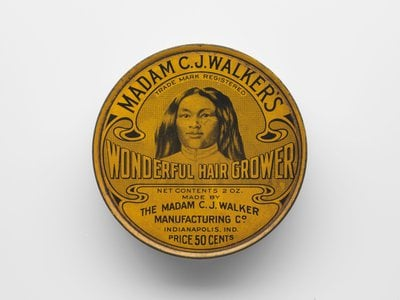 On the lid of the two-ounce can of Madam C. J. Walker's Wonderful Hair Grower, her top-selling product, appears an African-American woman with thick, flowing hair. That woman was Walker herself.