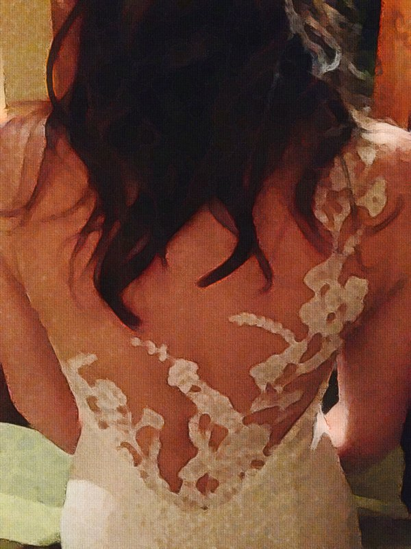 The beautiful back of a bride's gown thumbnail