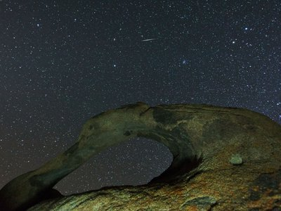 Geminids streak across the skies above the Alabama Hills. The approaching asteroid is thought to be the parent body of this annual meteor shower.