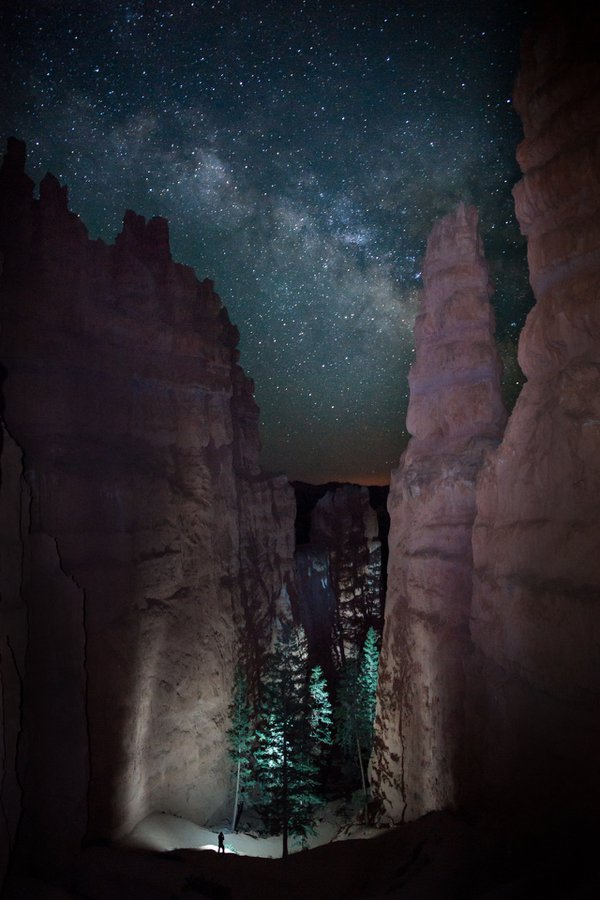 A lone hiker viewed the path before him as the Milky Way rose in the night Sky.  The towering Hoodoos stood high casting an immense silence in the canyon below. thumbnail