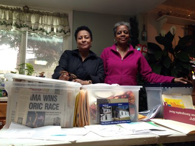 Mills (left) and Buck (right) use painstakingly gathered documents to spread knowledge of local black history.