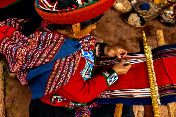 A woman weaving yarn in a village in Peru's Sacred Valley thumbnail