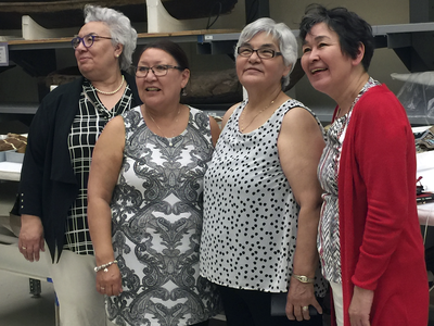 Manitok Thompson, Veronica Connelly, Rosie Kowna Oolooyuk, and Bernadette Dean at the National Museum of the American Indian's Cultural Resources Center. The four women—skilled caribou and sealskin clothing makers, and fluent Inuktitut-speakers and knowledge keepers—traveled to Washington from Nunavut as guests of the Embassy of Canada to attend the opening of the embassy's exhibition