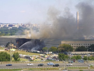 Smoke pours from the west wing of the Pentagon building September 11, 2001 in Arlington, Virginia, after a plane crashed into the building and set off a huge explosion.