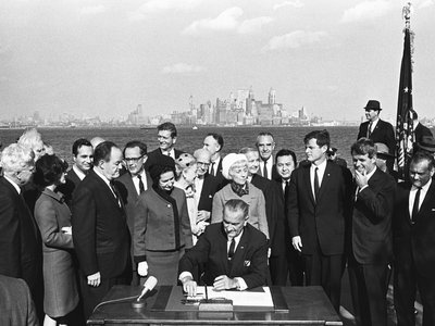 President Lyndon B. Johnson signs the Immigration and Nationality Act of 1965 on Liberty Island in New York Harbor.
