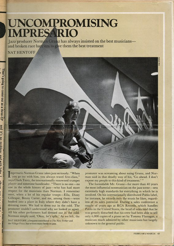 Magazine page featuring image of Granz sitting in front of trumpet mural