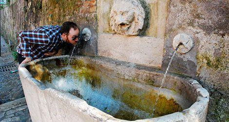 A public drinking fountain in Rome