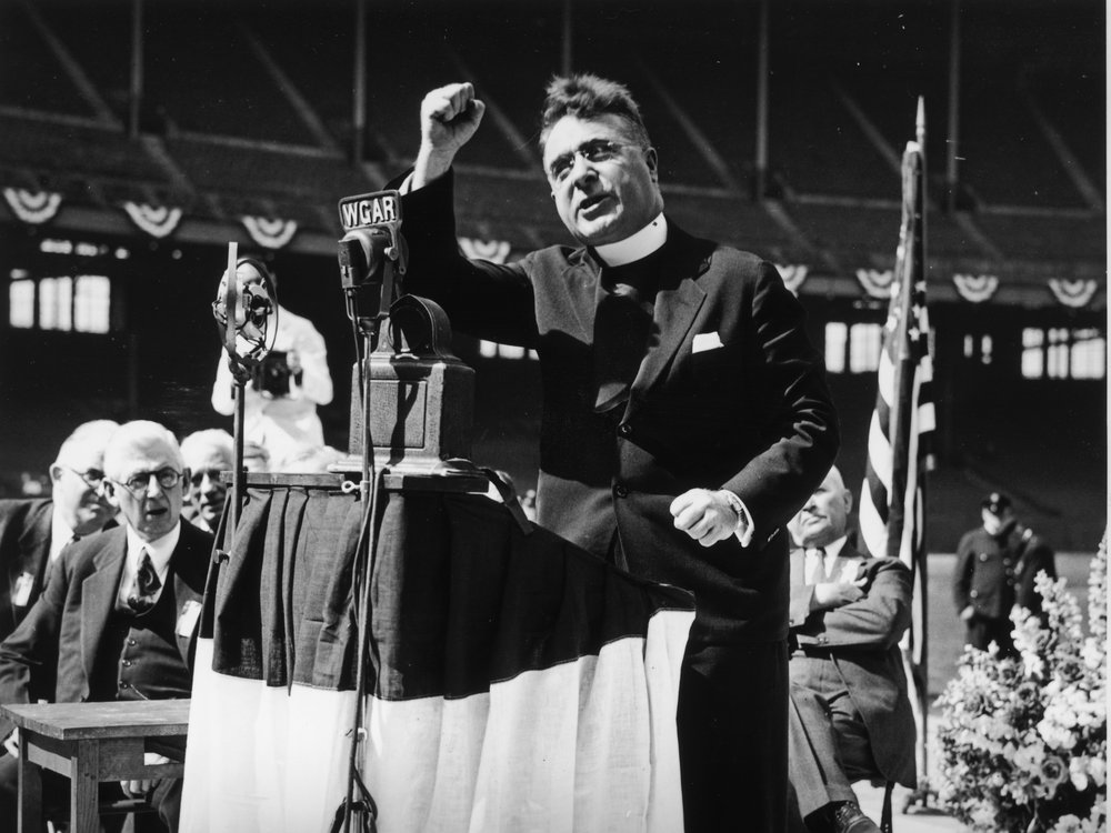 Father Charles Coughlin gives a radio message