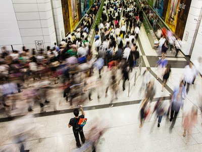 People seem to flow like river currents through the Central MTR subway station in Hong Kong.