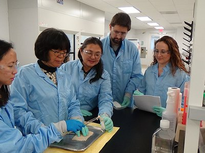 Acelity scientists evaluate a new prototype at the company's Regenerative Medicine Laboratory in Bridgewater, New Jersey.
